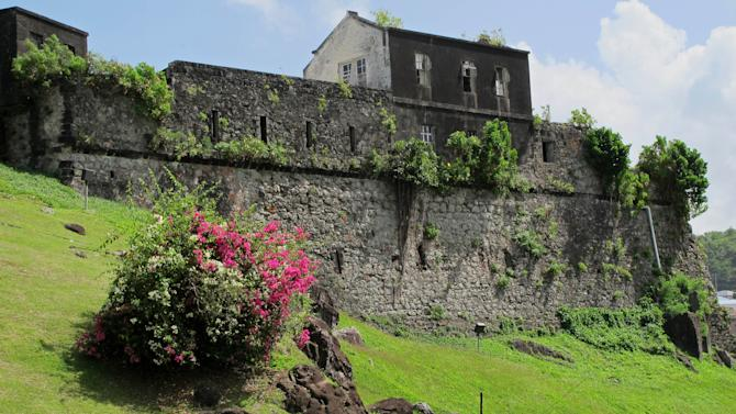 This picture taken Sunday, June 3, 2012, shows the exterior of Fort George, formerly known as Fort Rupert, where Grenada's former Prime Minister Maurice Bishop and seven others, including cabinet ministers, were captured and executed by an army firing squad on Oct. 14, 1983 in St. George's, Grenada. A haunting Cold War mystery is getting a fresh look on the Caribbean island of Grenada, where the body of the Marxist prime minister is still missing nearly 30 years after he was executed during a bloody coup that sparked a U.S. invasion. (AP Photo/David McFadden)