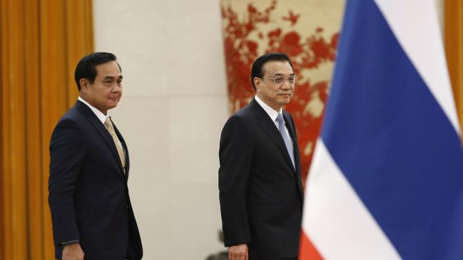 Thailand's Prime Minister Prayuth and China's Premier Li arrive for a welcoming ceremony inside the Great Hall of the People in Beijing