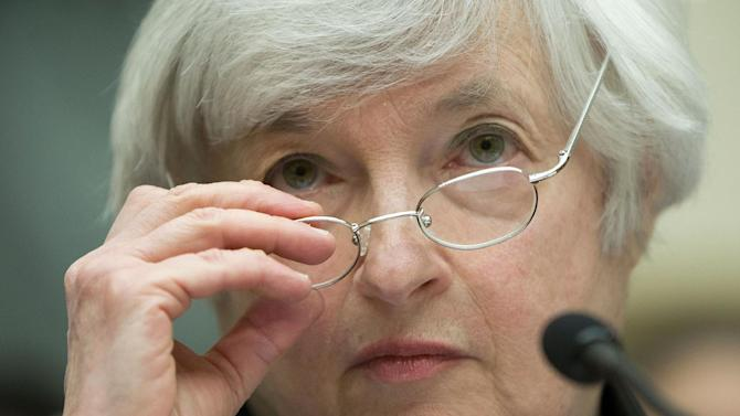 """Federal Reserve Chair Janet Yellen removes her glasses as she testifies on Capitol Hill in Washington, Wednesday, July 16, 2014, before the House Financial Services Committee hearing entitled: """"Monetary Policy and the State of the Economy. (AP Photo/Pablo Martinez Monsivais)"""