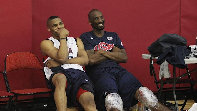USA men's basketball national team members Russell Westbrook, left, hangs out with teammate Kobe Bryant after practice at the Mendenhall Center on the UNLV campus in Las Vegas on Friday, July 6, 2012. (AP Photo/Las Vegas Review-Journal, Jason Bean)