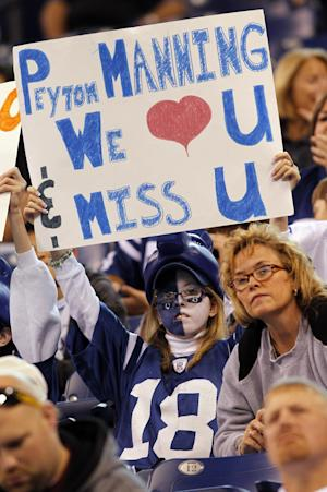 A fan holds a sign about injured Indianapolis Colts quarterback Peyton Manning who will miss his second game against the Cleveland Browns in an NFL football game in Indianapolis, Sunday, Sept. 18, 2011. (AP Photo/AJ Mast)