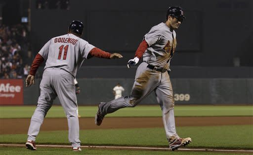 Garcia strikes out nine, Freese homers for Cards