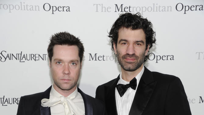 "Singer Rufus Wainwright, left, and boyfriend Jorn Weisbrodt attend the Metropolitan Opera's premiere of ""Le Comte Ory,"" sponsored by Yves Saint Laurent in New York. Publicist Bianca Bianconi confirmed Wainwright and Jorn Weisbrodt were married in a ceremony Thursday, Aug. 23, 2012. (AP Photo/Evan Agostini, File)"