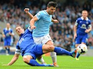 Manchester City forward Sergio Agüero (R) vies with Everton's Phil Jagielka during the English Premier League match at The Etihad stadium in Manchester, north-west England on October 5, 2013