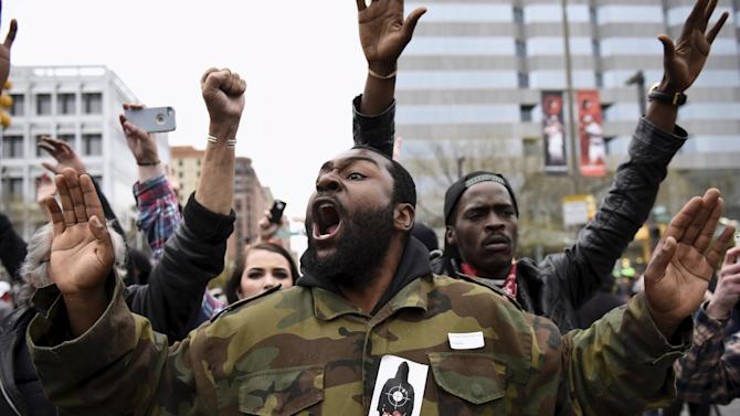 Demonstrators gesture near Camden Yards to protest against the death in police custody of Freddie Gray in Baltimore
