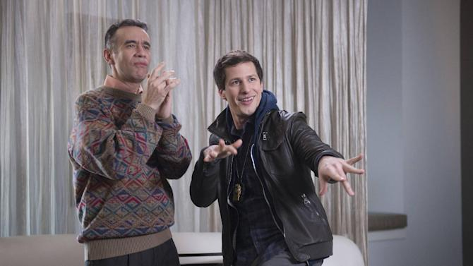 "This photo released by Fox shows, Andy Samberg, right, as Det. Jake Peralta and guest star, Fred Armisen as Melipnos , in a scene from the TV series, ""Brooklyn Nine-Nine,"" on Fox. (AP Photo/Fox, Eddy Chen)"