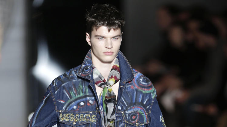 A model wears a creation of Versace men's Fall-Winter 2013-14 collection, part of the Milan Fashion Week, unveiled in Milan, Italy, Saturday, Jan. 12, 2013. (AP Photo/Antonio Calanni)
