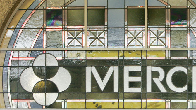 FILE - In this file photo made April 15, 2009, the Merck logo is seen in the lobby of Merck & Company, Inc.'s world headquarters in Whitehouse Station, N.J. Drugmaker Merck & Co. quadrupled its third-quarter profit Friday, Oct. 28, 2011, compared with a year-ago quarter weighed down by huge acquisition and legal charges. (AP Photo/Mel Evans, File)
