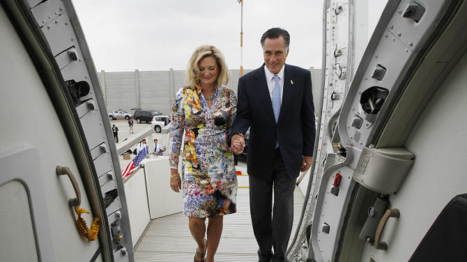 Republican presidential candidate and former Massachusetts Gov. Mitt Romney and his wife Ann board their charter plane in Tel Aviv, Israel as they travel to Poland, Monday, July 30, 2012. (AP Photo/Charles Dharapak)