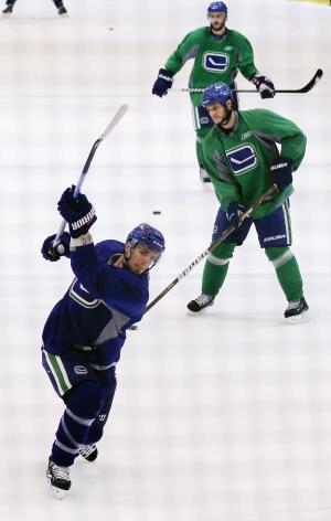 Vancouver Canucks left wing Alex Burrows (14) takes shots on goal during practice for the NHL hockey Stanley Cup Finals, Friday, June 3, 2011, in Vancouver, British Columbia. The Canucks host the Boston Bruins in Game 2 of the best-of-seven games series on Saturday. The Canucks lead 1-0. (AP Photo/Julie Jacobson)