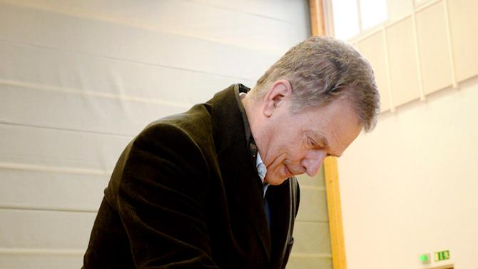 Finland President Sauli Niinisto casts his vote in Espoo, Finland, Sunday April 19, 2015. Finns are voting in parliamentary elections that will determine which coalition of parties can lead the country out of a three-year recession. (Mikko Stig/Leutikuva via AP) FINLAND OUT
