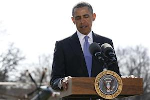U.S. President Obama pauses while making a statement about Ukraine on the South Lawn of the White House in Washington