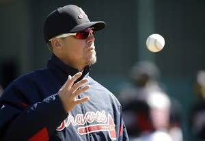 Former Atlanta Braves third baseman Chipper Jones catches a ball during a spring training baseball workout, Sunday, Feb. 17, 2013, in Kissimmee, Fla. Jones is attending Braves camp as a guest instructor. (AP Photo/David J. Phillip)