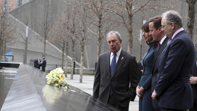 New York City Mayor Michael Bloomberg, left, British Prime Minister David Cameron, second from right, and his wife Samantha pay their respects to World Trade Center victim, Katherine Wolf alongside her husband Charles, right, during a visit to the National September 11 Memorial, Thursday, March 15, 2012 in New York.  (AP Photo/Mary Altaffer, Pool)
