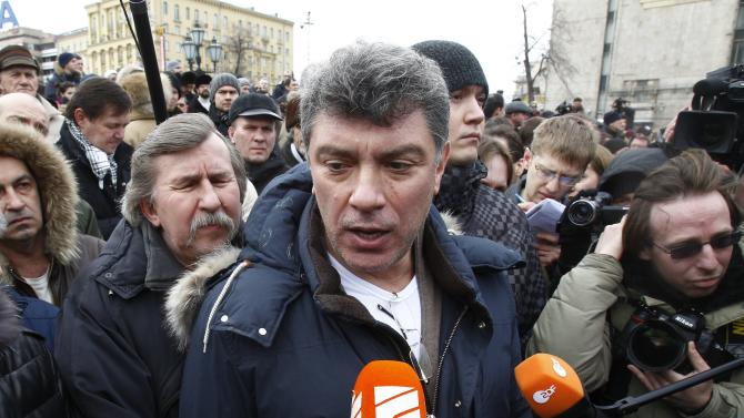 File photo of opposition leader Boris Nemtsov speaking to the media during a gathering of opposition supporters in central Moscow