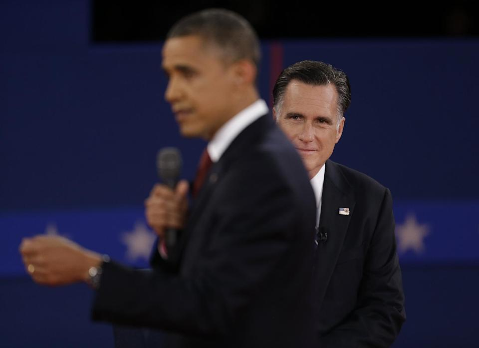 Republican presidential nominee Mitt Romney listens as President Barack Obama speaks during the second presidential debate at Hofstra University, Tuesday, Oct. 16, 2012, in Hempstead, N.Y. (AP Photo/David Goldman)