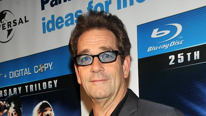 """FILE - This Oct. 25, 2010 file photo originally released by Universal Studios Home Entertainment shows singer Huey Lewis at the """"Back to the Future"""" 25th Anniversary Trilogy Blu-ray / DVD reunion and launch party in New York. A woman is to be sentenced in May in Northern California for the theft of a rental car and laptop from singer Huey Lewis. Katherine Bowyer Gallagher has pleaded guilty to a felony charge of possession of stolen property. The Marin Independent Journal reports sentencing for the 31-year-old is May 15.  (AP Photo/Universal Studios Home Entertainment, Diane Bondareff)"""