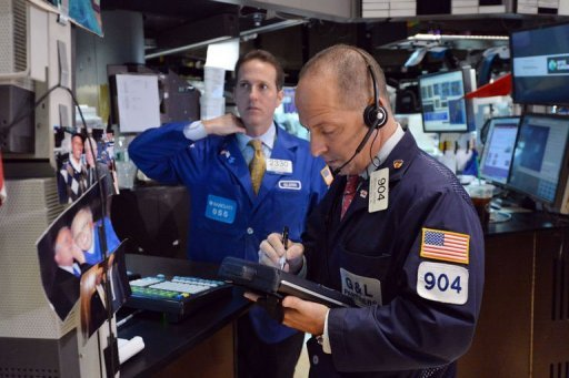 &lt;p&gt;A trader (R) works on the floor of the New York Stock Exchange. US stocks slid sharply Thursday, with the Dow Jones Industrial Average sinking two percent, as disappointing economic data from China and Europe followed the Federal Reserve&#39;s slashing its growth forecast for the United States.&lt;/p&gt;