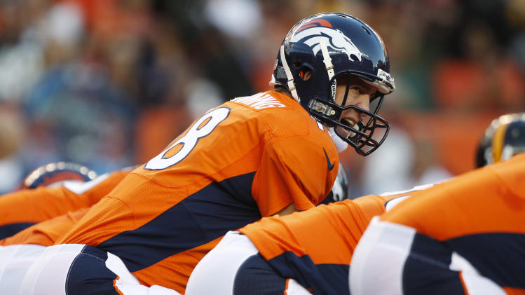 Denver Broncos quarterback Peyton Manning lines up against the Pittsburgh Steelers during the first quarter of an NFL football game, Sunday, Sept. 9, 2012, in Denver. (AP Photo/David Zalubowski)