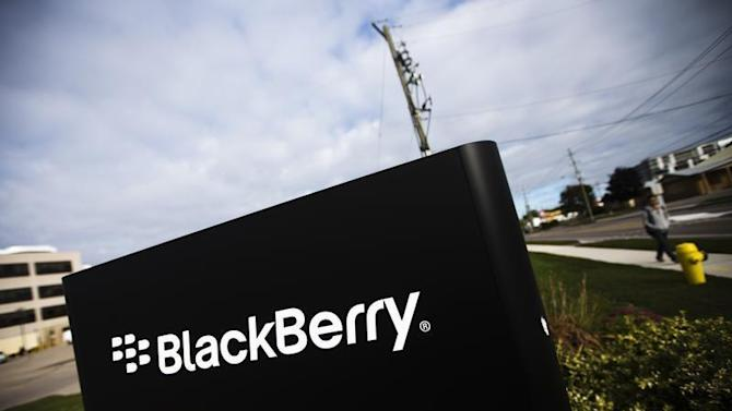 A man walks by a Blackberry sign at the Blackberry campus in Waterloo
