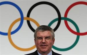 IOC President Bach attends a news conference in Tokyo