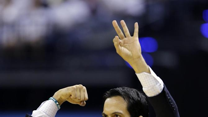 Miami Heat head coach Erik Spoelstra directs his team against the Indiana Pacers during the first half of Game 3 of the NBA Eastern Conference basketball finals in Indianapolis, Sunday, May 26, 2013. (AP Photo/Nam H. Huh)