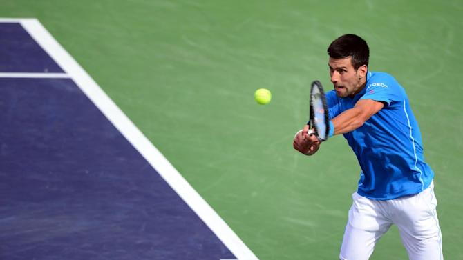 Novak Djokovic of Serbia hits a backhand return from the baseline during the men's final of the BNP Paribas Tennis Open in Indian Wells, California on March 22, 2015