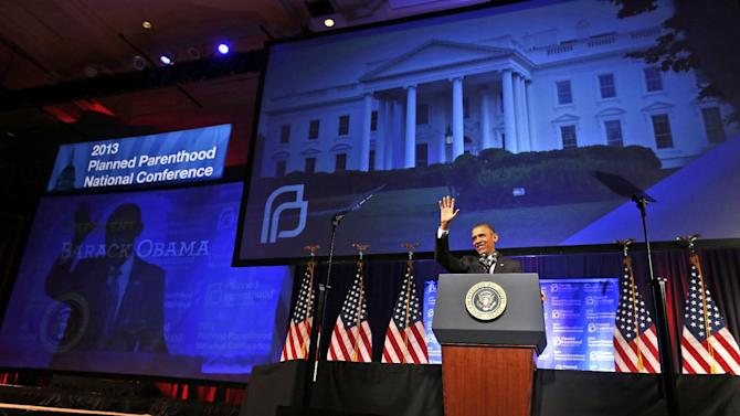 """FILE - President Barack Obama speaks at the 2013 Planned Parenthood National Conference in Washington on Friday, April 26, 2013. Obama, who supports abortion rights, became the first sitting president to make an in-person address to Planned Parenthood, vowing to help fight against state abortion restrictions that he said are designed to """"turn back the clock to policies more suited to the 1950s than the 21st century."""" (AP Photo/Charles Dharapak)"""