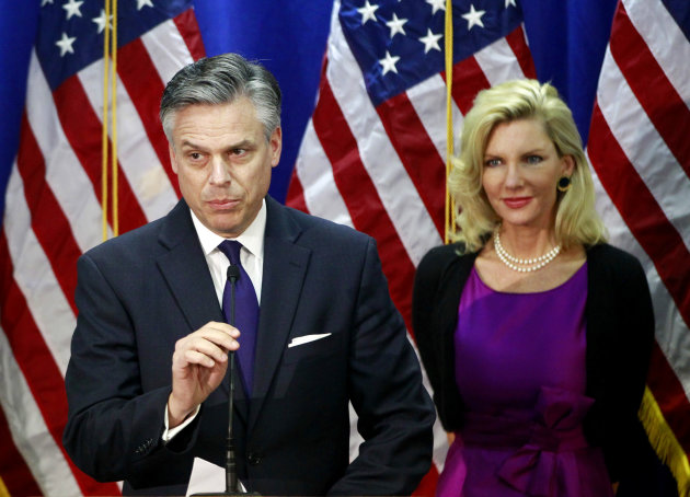 Republican presidential candidate, former Utah Gov. Jon Huntsman, accompanied by his wife Mary Kaye Huntsman, announces he is ending his campaign, Monday, Jan. 16, 2012, in Myrtle Beach, S.C. (AP Photo/Charles Dharapak)