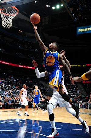 Lee, Warriors hold off Hawks' rally, 85-82