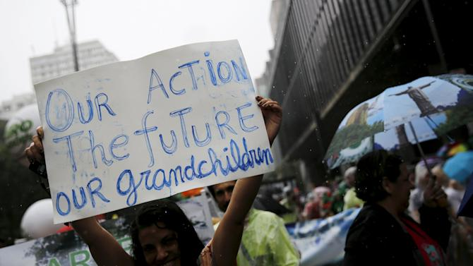 Activist takes part in a rally held the day before the start of the Paris Climate Change Conference (COP21), in Sao Paulo