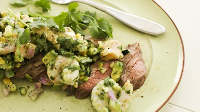In this image taken on May 13, 2013, a recipe for pepper-lime flank steak with shrimp and salmon ceviche is displayed in Concord, N.H. (AP Photo/Matthew Mead)