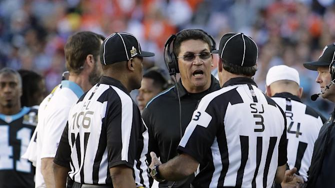 Carolina Panthers' head coach Ron Rivera talks to the referees during the first half of the NFL Super Bowl 50 football game Sunday, Feb. 7, 2016, in Santa Clara, Calif. (AP Photo/Matt York)