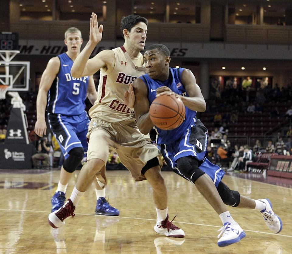 Duke's Rasheed Sulaimon (14) drives against Boston College's Danny Rubin (31) during the first half of an NCAA college basketball game in Boston, Sunday, Feb. 10, 2013. (AP Photo/Mary Schwalm)