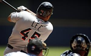 Lee has solid debut as Marlins beat Brewers 4-0