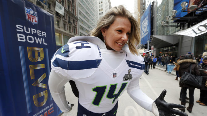Aline Colvero of Porto Alegre, Brazil poses for a photograph on Super Bowl Boulevard in Times Square in New York on Friday, Jan. 31, 2014. The Seattle Seahawks play the Denver Broncos on Sunday at the stadium in the NFL Super Bowl XLVIII football game. (AP Photo/Paul Sancya)