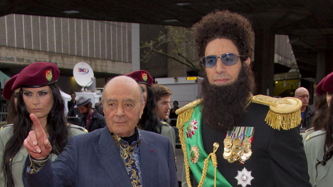British actor Sacha Baron Cohen, right, who plays Admiral General Aladeen, and Egyptian businessman Mohammed Al Fayed arrive for the World Premiere of 'The Dictator', at a cinema in Soutbank in central London, Thursday, May 10, 2012. (AP Photo/Joel Ryan)