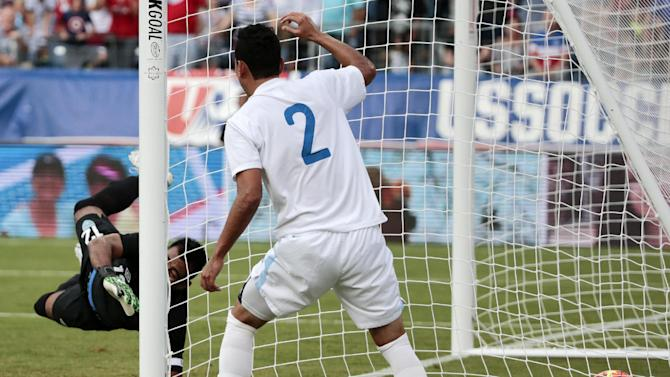 Guatemala goalkeeper Paulo Motta, left, reaches for an own goal by Carlos Castrillo, not seen, as defender Ruben Morales (2) watches during the first half of an international friendly soccer match against the United States on Friday, July 3, 2015, in Nashville, Tenn. (AP Photo/Mark Humphrey)