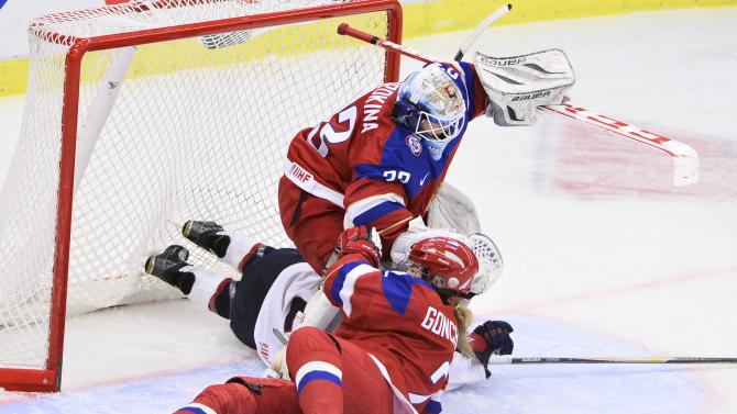 Russia's Angelina Goncharenko foreground and USA's  Hannah Brandt, centre,  fall in front of Russia's goalkeeper Maria Sorokina, during the 2015 Women's Hockey World Championship group A match between Russia and USA, at Malmo Isstadion in Malmo, southern Sweden, Tuesday, March 31, 2015.  (AP Photo/TT, Claudio Bresciani) SWEDEN OUT