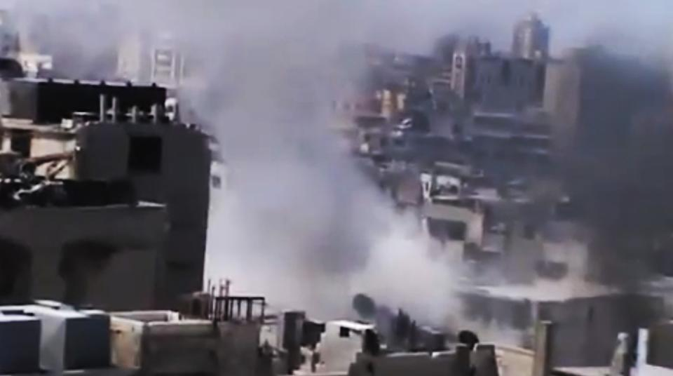 In this image made from amateur video released by the Ugarit News and accessed Monday, July 23, 2012, smoke rises from buildings in Homs, Syria. (AP Photo/Ugarit News via AP video) TV OUT, THE ASSOCIATED PRESS CANNOT INDEPENDENTLY VERIFY THE CONTENT, DATE, LOCATION OR AUTHENTICITY OF THIS MATERIAL