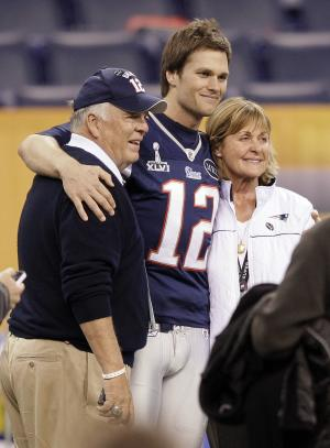 New England Patriots quarterback Tom Brady (12) poses for a photo with his parents, Tom and Galynn Brady, in Lucas Oil Stadium on Saturday, Feb. 4, 2012, in Indianapolis. The Patriots are scheduled to face the New York Giants in NFL football Super Bowl XLVI on Feb. 5. (AP Photo/Mark Humphrey)