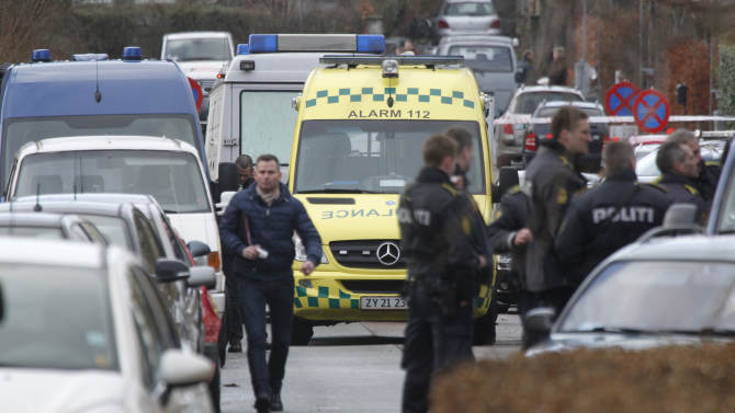 Danish police attend the crime scene after a shooting incident, Tuesday, Feb. 5, 2013, in Copenhagen, Denmark.  The Danish writer and prominent Islam critic, Lars Hedegaard, survived an attempted assassination Tuesday at his home in Copenhagen, the advocacy group Danish Free Press Society, that he heads said Tuesday.  No injuries are reported.  (AP Photo/Jens Dresling, POLFOTO) DENMARK OUT