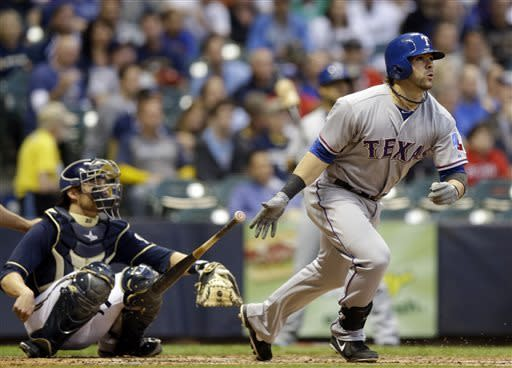 Holland, Kinsler lead Texas to win over Brewers