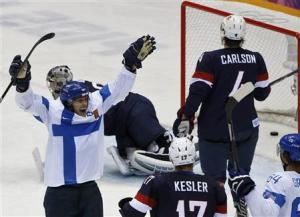 Finland's Selanne celebrates his goal as Team USA's Kesler and Carlson react during the third period of their men's ice hockey bronze medal game at the Sochi 2014 Winter Olympic Games
