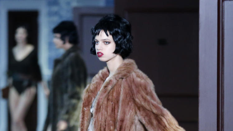 A model presents a creation by U.S fashion designer Marc Jacobs for Louis Vuitton's Ready to Wear's Fall-Winter 2013-2014 fashion collection, presented, Wednesday, March 6, 2013 in Paris. (AP Photo/Jacques Brinon)