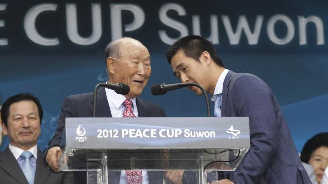 In this July 19, 2012 photo, Rev. Sun Myung Moon, the founder of the Unification Church, left, is escorted by his son, Hyung-jin Moon during the opening ceremony of the 2012 Peace Cup Suwon at Suwon World Cup Stadium in Suwon, South Korea. Moon, the self-proclaimed messiah who founded the church, died Monday, Sept. 3, 2012, at a church-owned hospital near his home in Gapyeong County, northeast of Seoul, church officials said. He was 92. (AP Photo/Ahn Young-joon)