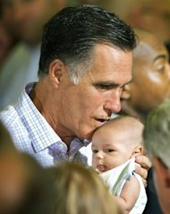 Republican presidential hopefull Mitt Romney kisses a baby from the crowd after delivering remarks on the economy in Irwin, Pennsylvania. Campaigning ahead of November's presidential vote has become increasingly rancorous, as President Barack Obama and Romney trade attack ads and bitter accusations of lies and cover-ups