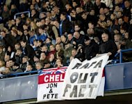Chelsea supporters hang a banner protesting against interim manager Rafael Benitez at Stamford Bridge on November 25. The former Liverpool coach was roundly booed during Chelsea&#39;s 0-0 draw with Manchester City in his first game at the helm on Sunday