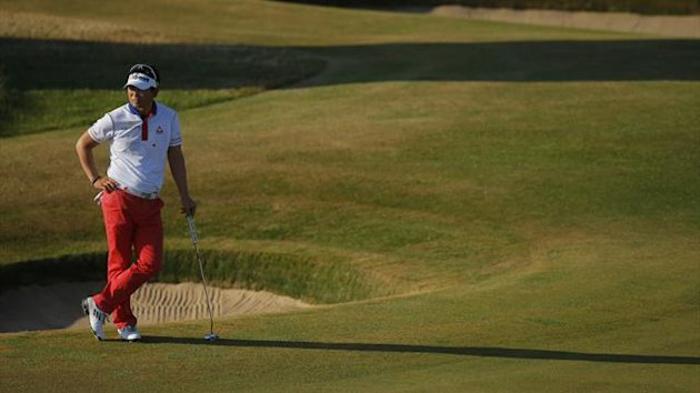Yang Yong-eun of South Korea waits on the fifth green during the second round of The Open at Muirfield (Reuters)