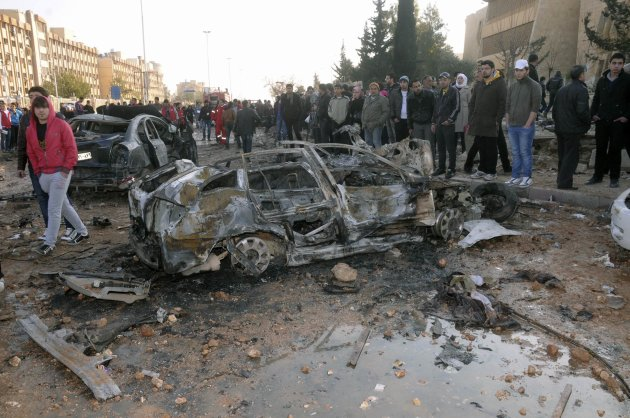 """People gather at the site where two explosions rocked the University of Aleppo in Syria's second largest city, January 15, 2013. At least 15 people were killed and dozens wounded in two explosions that rocked the University of Aleppo in Syria's second largest city on Tuesday, the Syrian Observatory for Human Rights said. State television described the explosion at the university which lies in the government-controlled area, as a """"terrorist attack"""". REUTERS/George Ourfalian (SYRIA - Tags: POLITICS CIVIL UNREST)"""